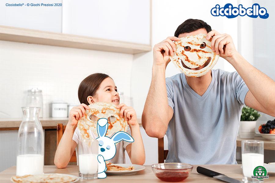 un papà prepara la colazione con sua figlia